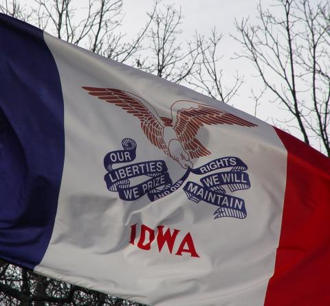 Iowa state motto on the flag of Iowa
