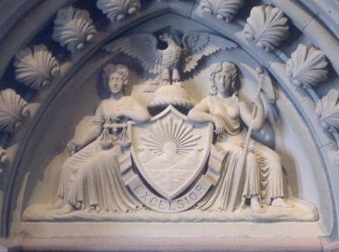 New York state motto (Excelsior) on bas-relief sculpture