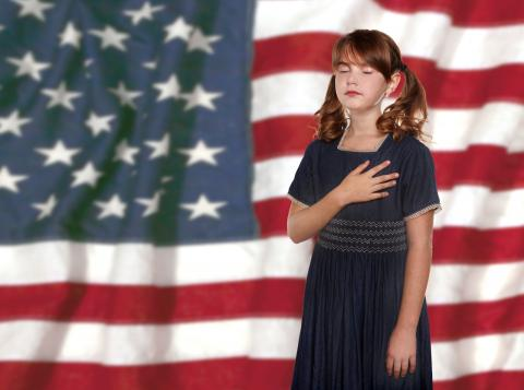 Child saying the pledge of Allegiance to United States