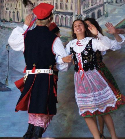 Polka dancers in traditional costumes