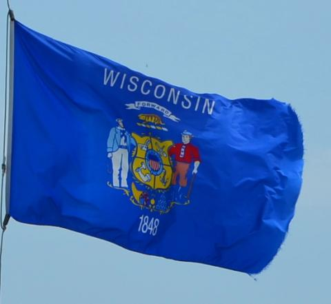 Wisconsin state flag flying in the breeze