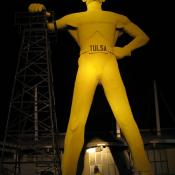 The Golden Driller monument at night