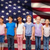 Cute kids with American flag in background