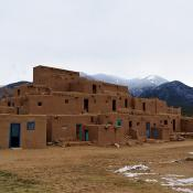 Taos Pueblo with the Sangre de Cristo Mountains in the background.