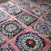 Quilt with pine burr patches