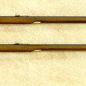 Two long rifles; one percussion and one flintlock