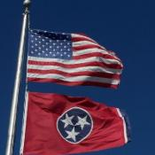 Tennessee and U.S. flags waving