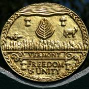 Vermont state seal atop the official state marker in Burlington VT